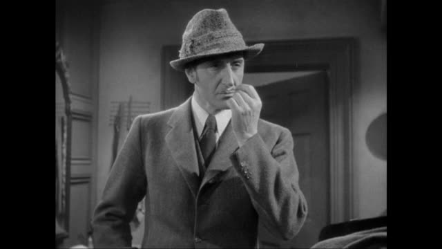 1946 sherlock holmes (basil rathbone) smells discarded cigarette - tobacco product stock videos & royalty-free footage