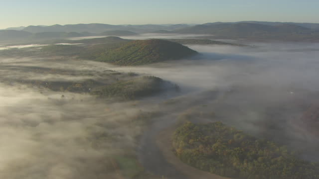 ws aerial pov sherman farm maze in misty landscape at dawn, mountains in background / fryeburg, oxford county, maine, united states - echtzeit stock-videos und b-roll-filmmaterial