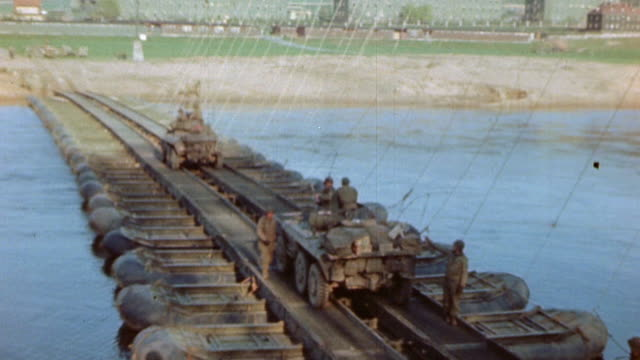 sherman tank and other us army vehicles crossing the weser river on sapperbuilt pontoon bridge during world war ii european campaign / germany - pontoon bridge stock videos and b-roll footage