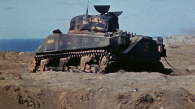 sherman tank called agony knocked out during the assault on hill peter / iwo jima japan - schlacht um iwojima stock-videos und b-roll-filmmaterial