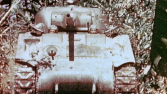 sherman tank driving down narrow dirt roadway jungle on either side / saipan mariana islands - saipan stock videos and b-roll footage