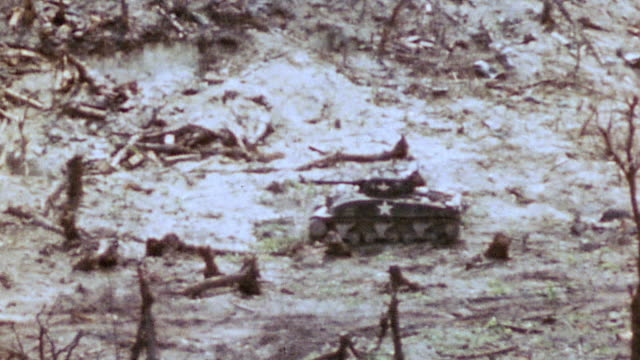 sherman tanks advancing across a blasted scorched battlefield / iwo jima japan - schlacht um iwojima stock-videos und b-roll-filmmaterial