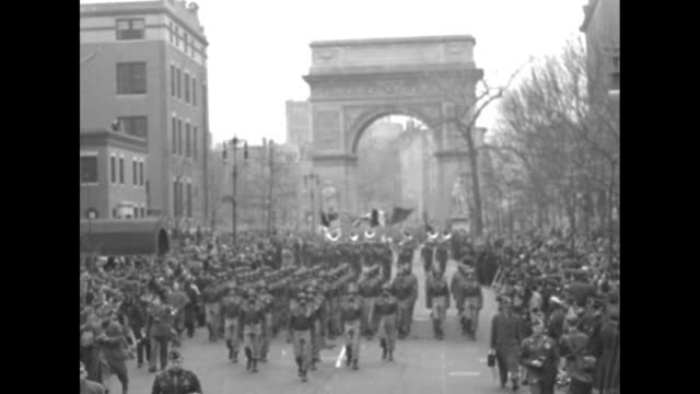 Sherman tanks artillery paratroopers marching in formation down 5th Avenue past the Metropolitan Museum of Art during victory parade after World War...