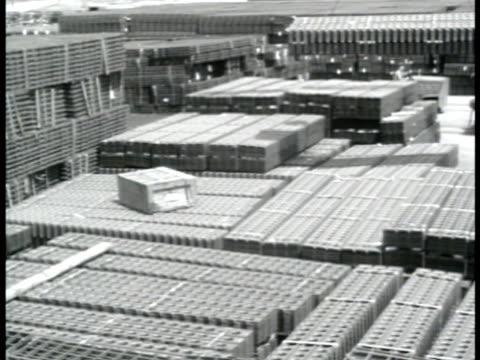 stockvideo's en b-roll-footage met sherman tanks parked in field supply yard w/ crane moving rectangular bundle us soldiers walking by stockpile of rolled metal fencing men w/ hand... - pantservoertuig
