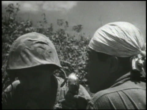 Sherman tanks waiting soldier setting up speaker Japanese prisoner of war requesting fellow troops to surrender VS Chamorro people revealing...