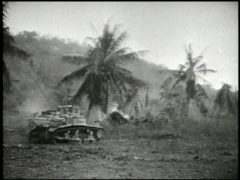 sherman variant medium tank 2nd amp 4th marine divisions amp 27th infantry regiment soldiers advancing inland firing rifle walking across field w/... - mariana islands stock videos and b-roll footage