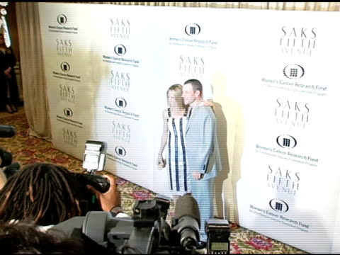 vídeos de stock, filmes e b-roll de sheryl crow and lance armstrong at the 2005 courage award given to lance armstrong at saks fifth avenue's unforgettable evening at the regent beverly... - regent beverly wilshire hotel