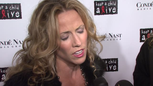 Sheryl Crow on looking fit why she is here to support 'Keep A Child Alive' and Bono how motherhood has changed her and is wearing Ralph Lauren at the...