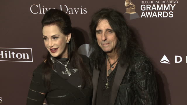 stockvideo's en b-roll-footage met sheryl goddard and alice cooper at the clive davis' and the recording academy's pre-grammy gala at the beverly hilton hotel on february 09, 2019 in... - alice cooper