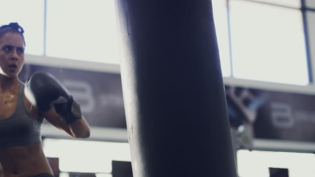 she's a fit and fierce fighter - punch bag stock videos and b-roll footage