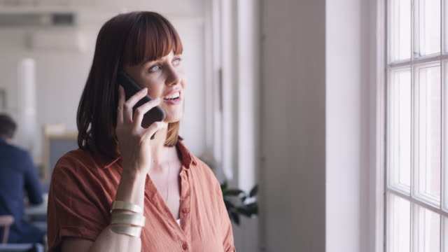 she's always on a call with success - redhead stock videos & royalty-free footage