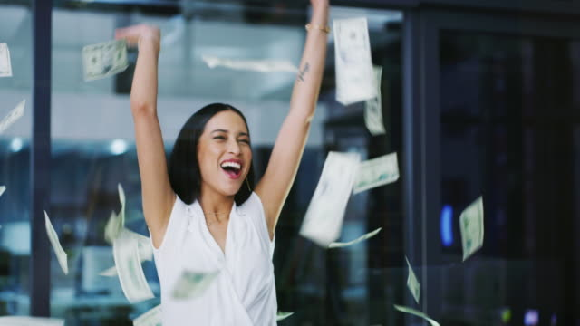 vídeos de stock e filmes b-roll de she's making it rain - making money
