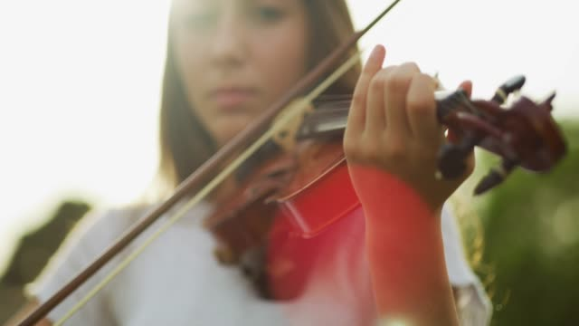 she's one talented individual - violin stock videos & royalty-free footage