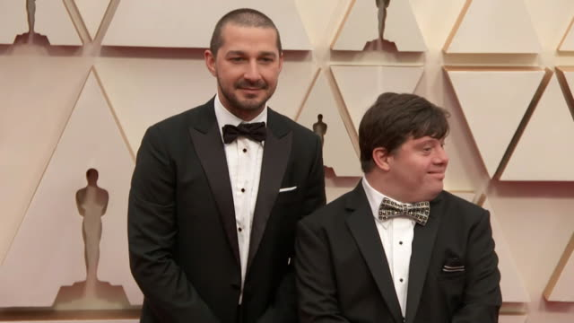 shia labeouf and zack gottsagen walking the red carpet at the 92nd annual academy awards at the dolby theater in los angeles, california. - music or celebrities or fashion or film industry or film premiere or youth culture or novelty item or vacations 個影片檔及 b 捲影像