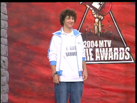 """shia labeouf walking the 2004 mtv movie awards red carpet. shia labeouf is wearing an """"i got served"""" t-shirt. - shia labeouf stock videos & royalty-free footage"""