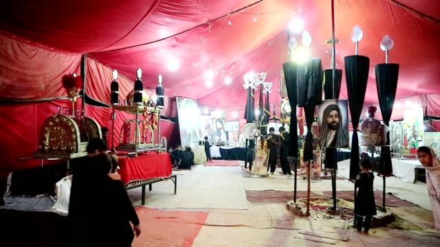 shia muslims kissing karbala flags for love and observing muharram - punjab pakistan stock videos & royalty-free footage