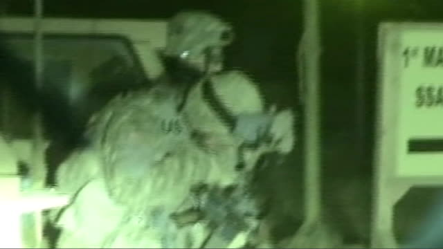 150 shia pilgrims killed by suicide bombers * * night vision shots us soliders preparing rifles side view of us solider driving along as speaking on... - babylon stock videos and b-roll footage