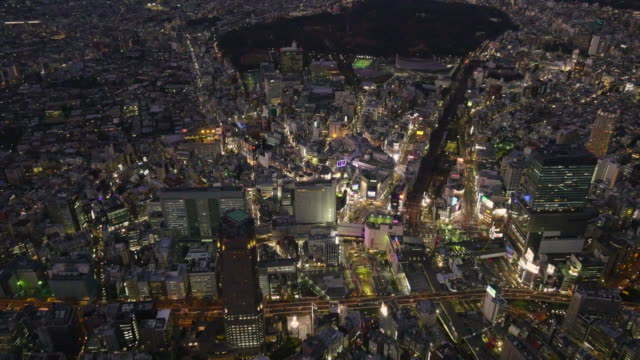 shibuya aerial view from helicopter at night - tokyo japan stock videos & royalty-free footage