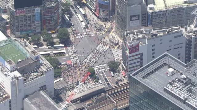 aerial, shibuya crossing during fifa world cup, tokyo, japan - international team soccer stock videos & royalty-free footage