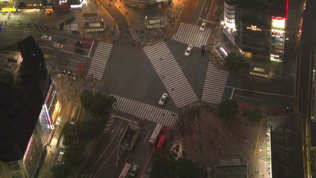 aerial, shibuya crossing in evening, tokyo, japan - tokyo japan stock videos & royalty-free footage