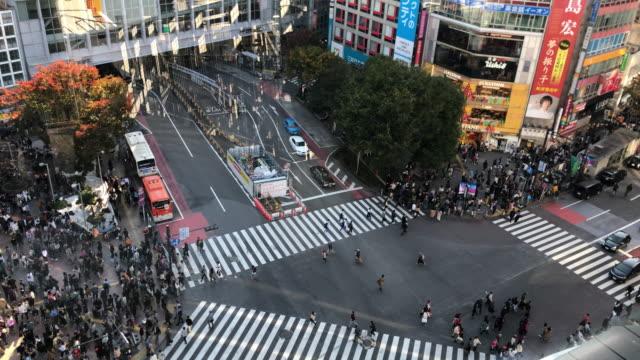 shibuya crossing in tokyo - crossroad stock videos & royalty-free footage