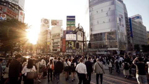 shibuya crossing intersection crowd slow motion tokyo japan. - shibuya ward stock videos & royalty-free footage