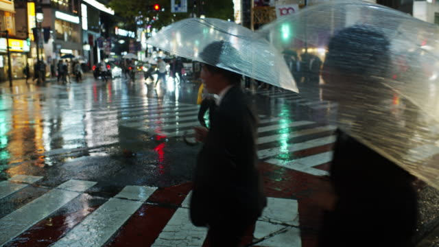 shibuya crossing on rainy night - slow motion - road signal stock videos & royalty-free footage