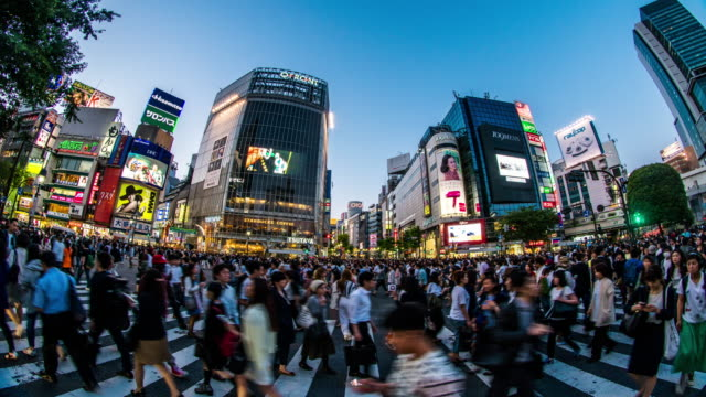 shibuya crossing time lapse 4k - population explosion stock videos & royalty-free footage