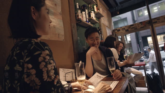shibuya friends aperitif slow motion tokyo japan. - menu stock videos & royalty-free footage