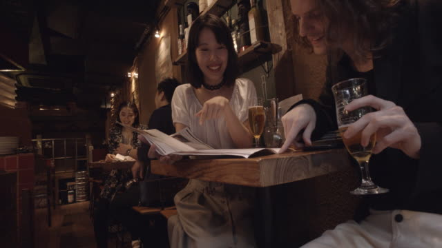 shibuya friends looking menus slow motion tokyo japan. - menu stock videos & royalty-free footage