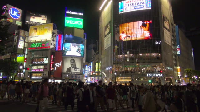 shibuya intersection at night - tokyo japan stock videos & royalty-free footage