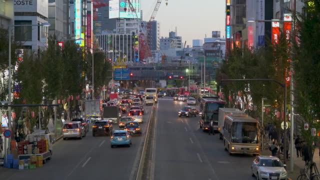 shibuya road traffic in the evening - compartment stock videos & royalty-free footage