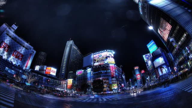 shibuya; scramble crosswalk; passersby and running cars; night view: sfx; fish-eye shot; time lapse. - wide angle stock videos & royalty-free footage