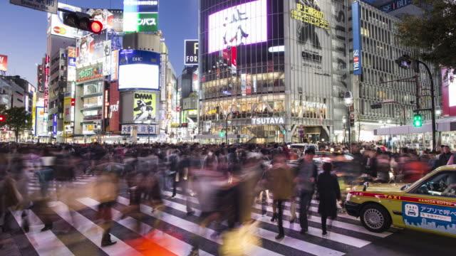 WS, TL Shibuya scramblewalk at dusk / Tokyo, Japan