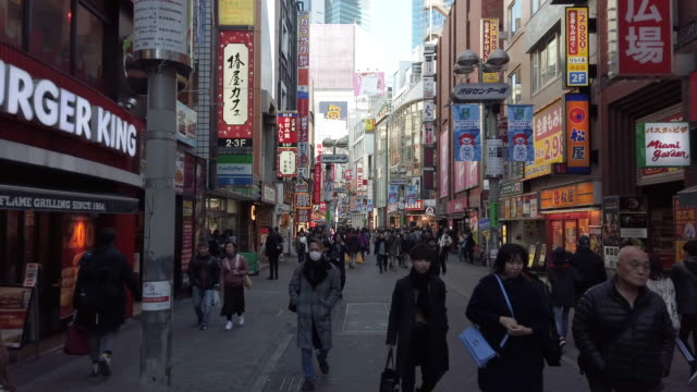 4k ws shibuya shopping street district in tokyo, japan. - tracking shot stock videos & royalty-free footage
