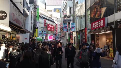 4k ws shibuya shopping street district in tokyo, japan. - tokyo japan stock videos & royalty-free footage
