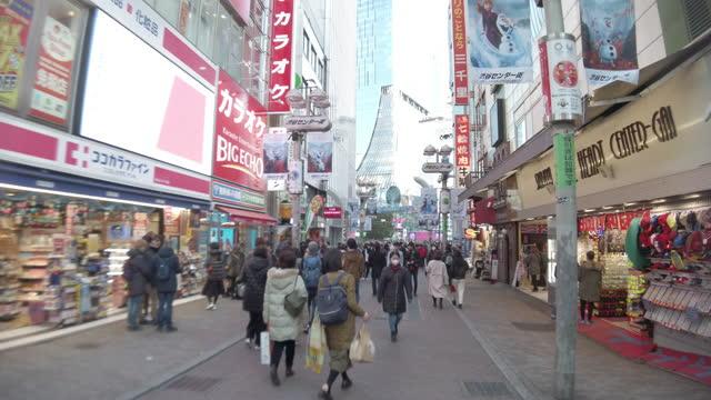 4k ws shibuya shopping street district in tokyo, japan. - wide stock videos & royalty-free footage