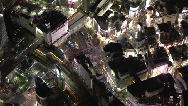 aerial, shibuya station at night, tokyo, japan - december stock videos & royalty-free footage