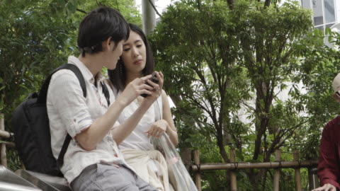 shibuya station japanese young couple  tokyo japan. - electronic organizer stock videos & royalty-free footage