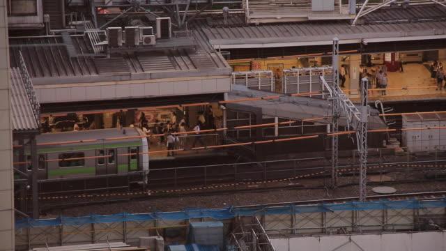 shibuya station landscape of evening - shibuya station stock videos and b-roll footage