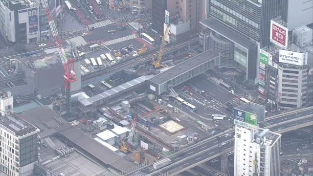 aerial, shibuya station under construction, tokyo, japan - crane construction machinery stock videos & royalty-free footage