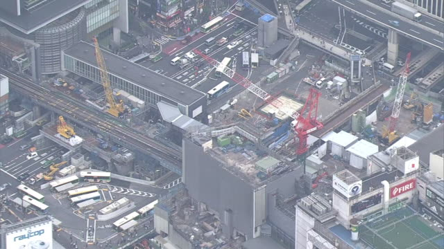 aerial, shibuya station under construction, tokyo, japan - crane construction machinery stock videos & royalty-free footage