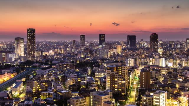 shibuya ward, tokyo - dusk to night time lapse - dusk to night stock videos & royalty-free footage