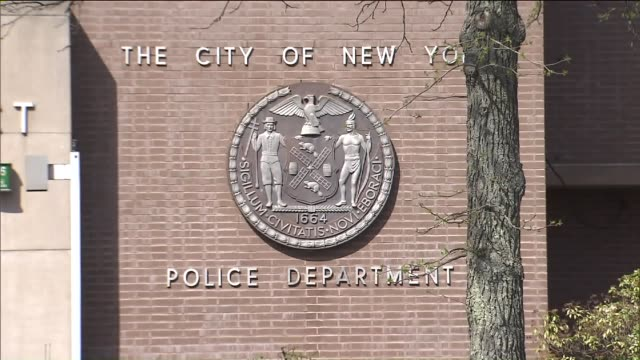 nypd shield outside of the 105th precinct - police station stock videos & royalty-free footage
