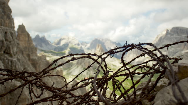 shift focus, mountains and barbwire - tre cimo di lavaredo stock videos & royalty-free footage