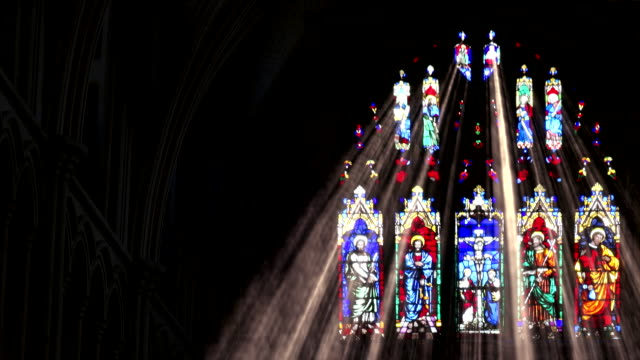 shifting stain glass light rays - cristianesimo video stock e b–roll