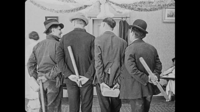 1920 Shifty men turn around to face oblivious woman, revealing the weapons behind their backs