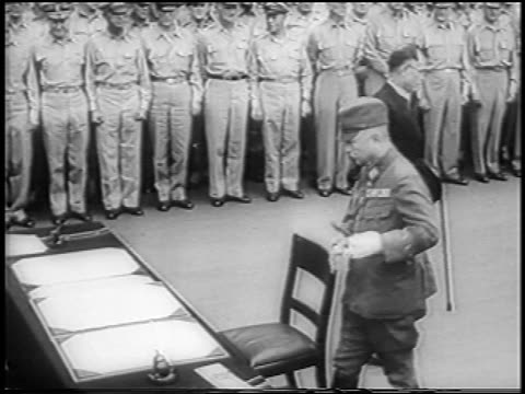 shigemitsu walks away from surrender table as general umezu signs for japanese army / news - japanese surrender stock videos & royalty-free footage