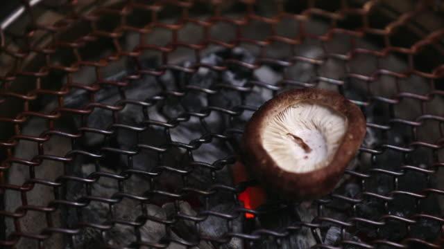 ecu td r/f shiitake mushroom on barbecue grill / seoul, south korea - shiitake stock videos & royalty-free footage