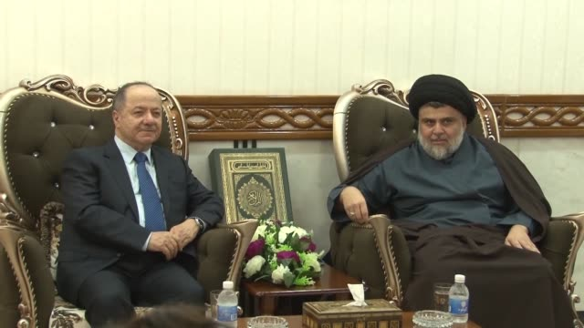 shiite cleric moqtada alsadr meets with massud barzani leader of the kurdistan democratic party in iraq's central shrine city of najaf - muqtada al sadr stock videos & royalty-free footage
